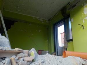 un edificio crollato nel terremoto dell'aquila del 2009
